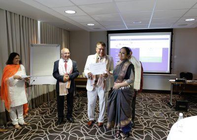 Mr. Joginder Kumar handing certificate to Gaurika, Odissi