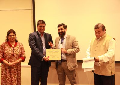 Mr Siddharth displaying certificate