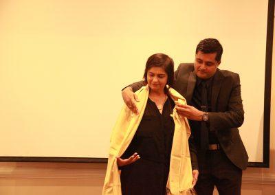 Mr. Abhay offering shawl to Krishna