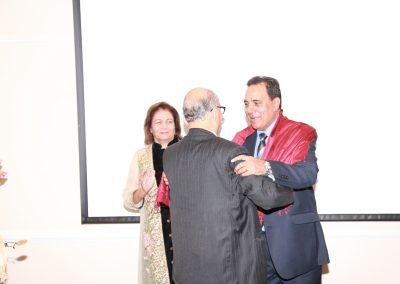 Mr. Gupta offering shawl