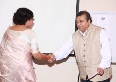 Mrs. Pattanayak shaking hand with Vinay